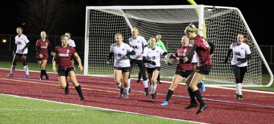 Trojans defend the goal from a corner kick.