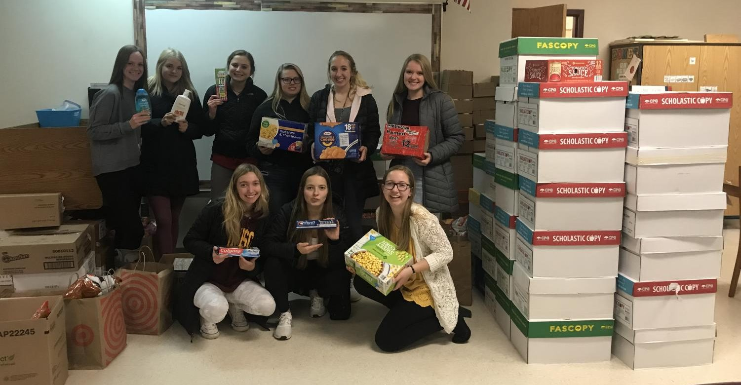 Student Council members show off the food they collected during the food drive.