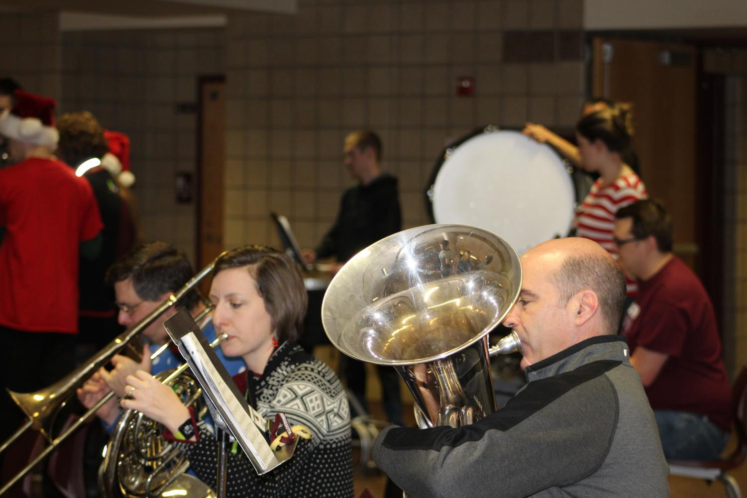 Staff joined students to bring holiday cheer the morning of Friday, December 20.
