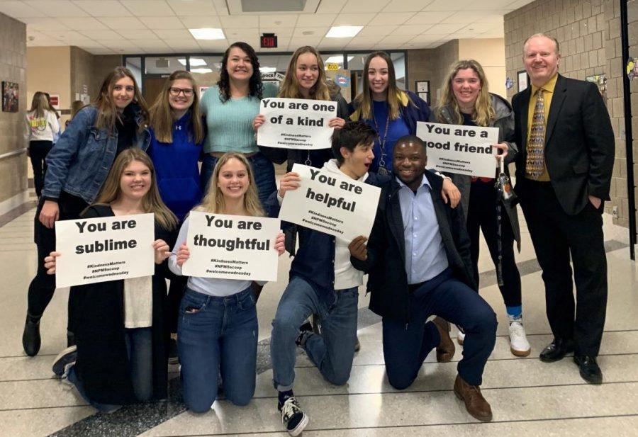 BRIDGE students pose with Middle School Principal Brad Gregor.