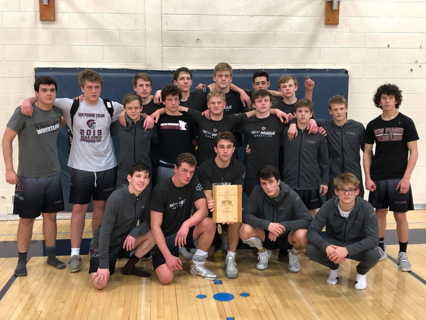 Trojan wrestlers took the championship at the Zelinski Memorial Dual Tournament at Whittnall High School in Greenfield, WI the weekend of January 24-25. In the championship round, New Prague defeated Mukwonago, WI (#1 team in WI's Division I) by a score of 40-28. Trojans won the tourney going 5-0!