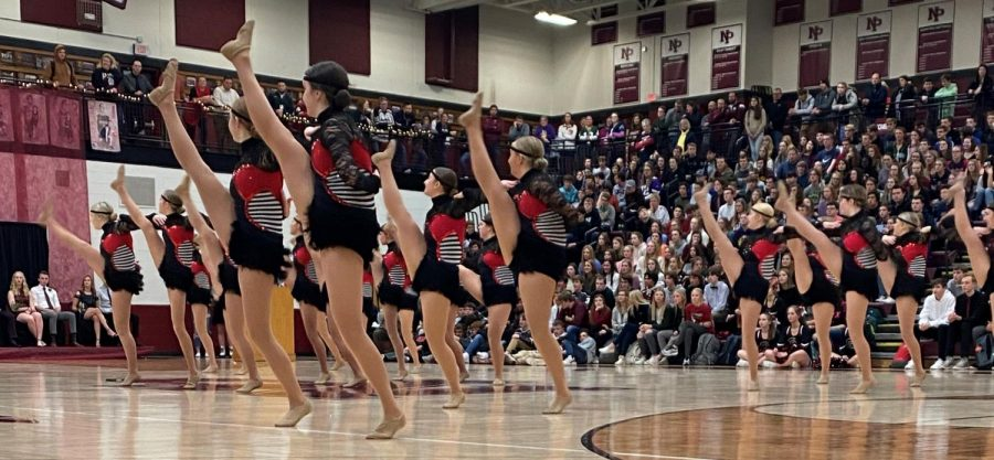 Check out the dance team's high kicks.