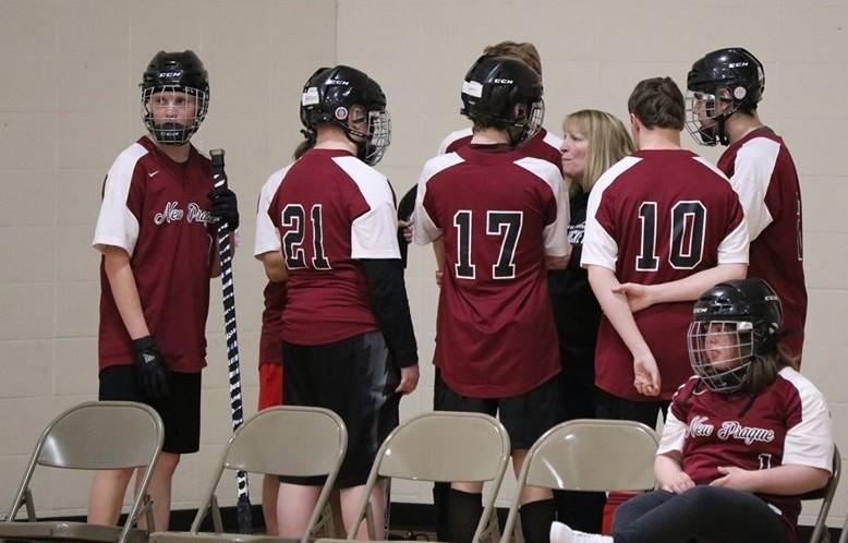 Coach Kriha speaks to her adaptive floor hockey team before taking on NPAS staff.