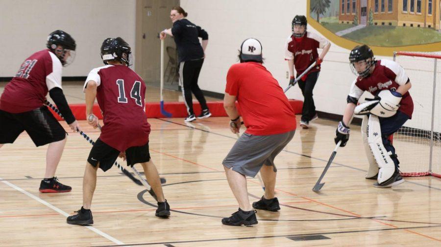 Action got intense when the adaptive floor hockey team took on NPAS staff.