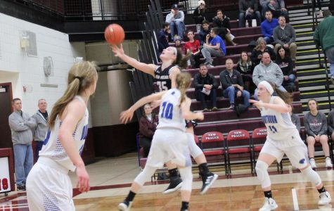 Amanda Giesen goes in for a lay-up and scores.