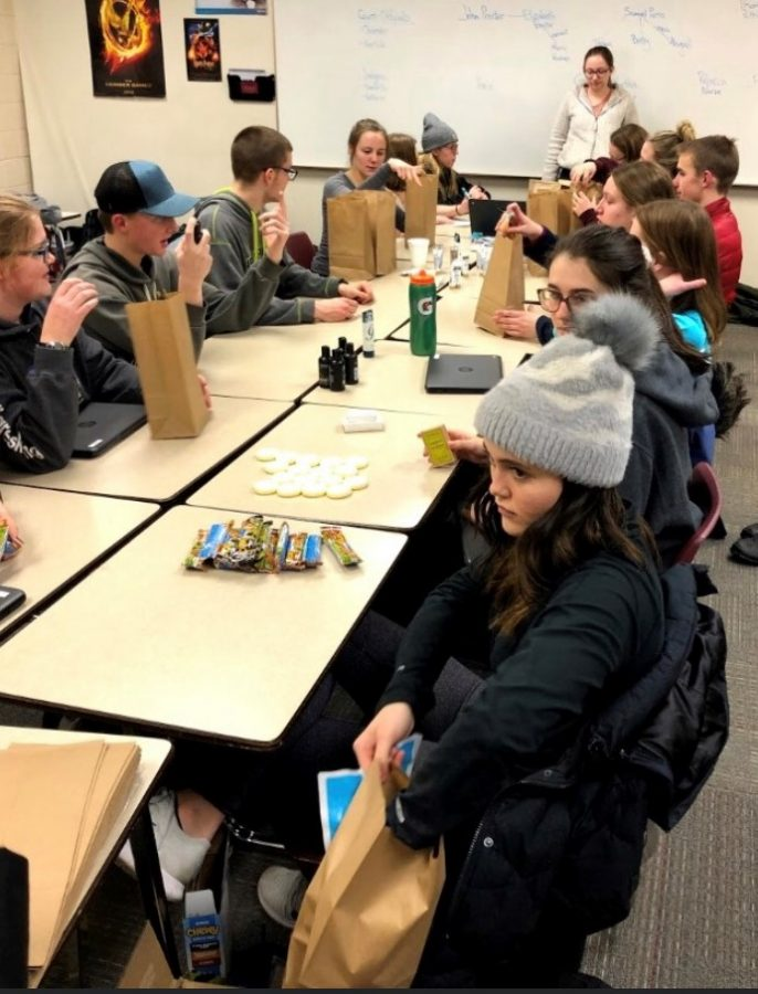 NHS Tent City participants compile care packages to send to Sharing and Caring Hands.