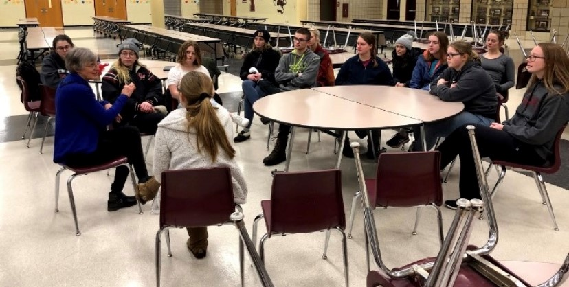 National Honor Society students, who made up the tent city participants, talk with Mary Higgins, coordinator of the local Hope House.