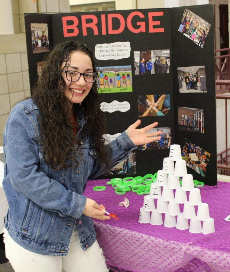 Jazmine Sanchez Rodriguez took a break from her Mexico table to show people how to build their own bridges.