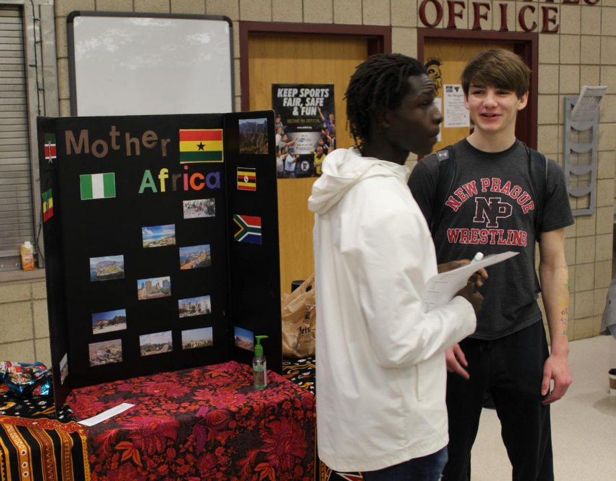 John Wacker talks about his African culture with a classmate.