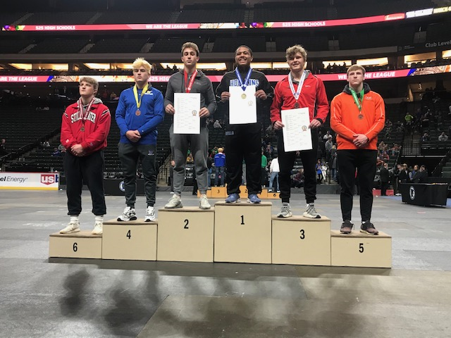 Will Busch accepts his second-place medal at the state wrestling tournament.