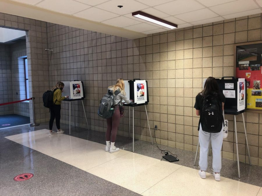 New Prague High School students experienced the privacy necessary to cast their votes.