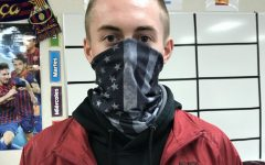 Jacob Helvick models the gaiter - another popular type of face covering.