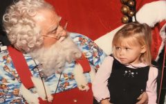 Ava Lyons seems a bit skeptical about Santa at an early age.