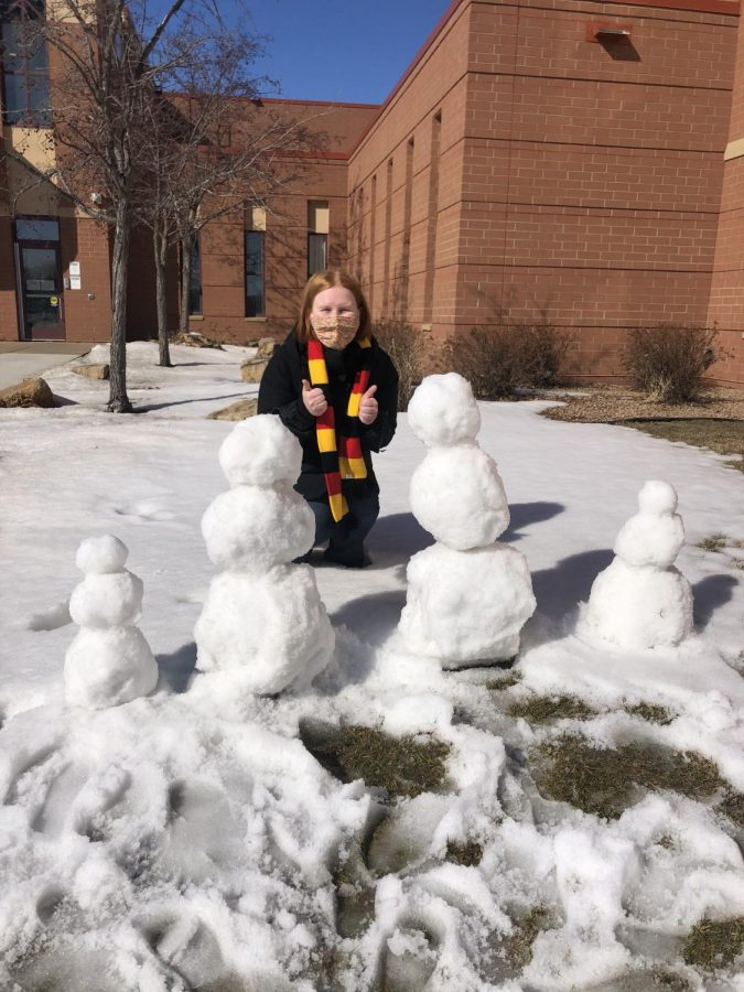 Ms. Vikla shows off her snow family.