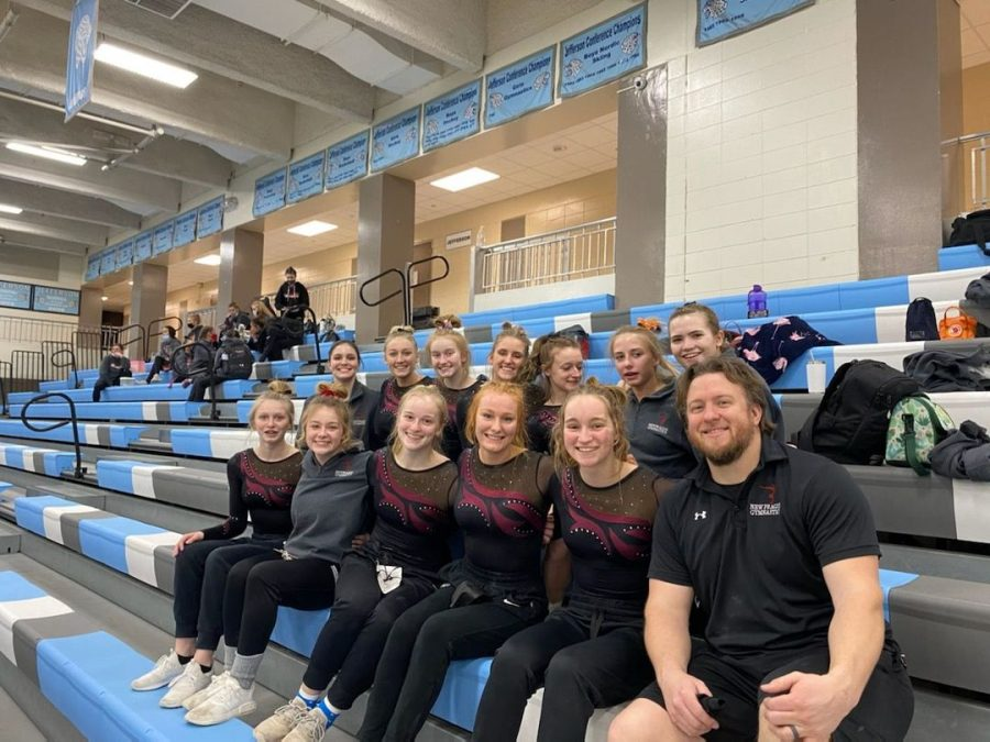 Trojan Gymnasts and coaches are state bound!